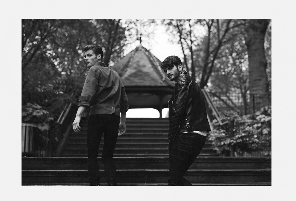 Black And White Portrait Of Two Men Walking Up Stairs To Garden In East London