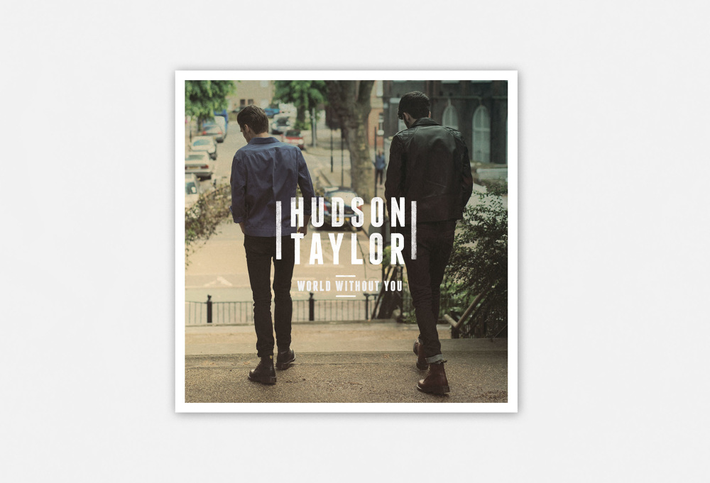 Two Men Descending Stairs In East London On Album Cover With White Logo