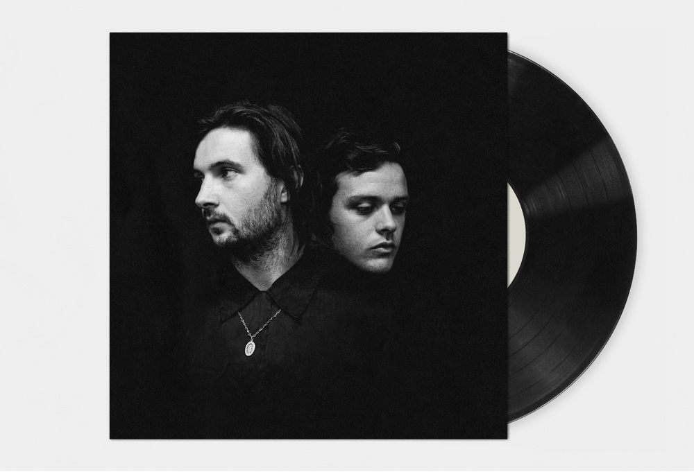 Black And White Portrait Album Cover Vinyl Of Two Men In Dark Space