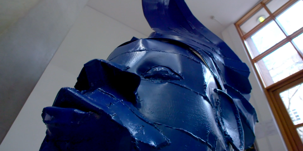 African Inspired Blue Sculpture In Museum Entrance Of University