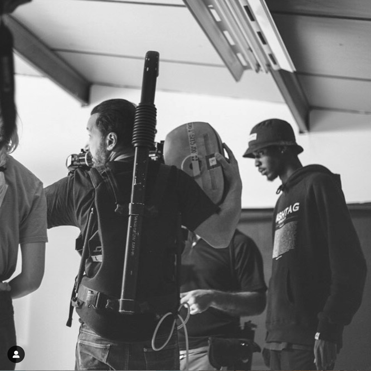Professional Photography Black Man Standing Behind Camera On Music Video Production With Crew Watching Performance