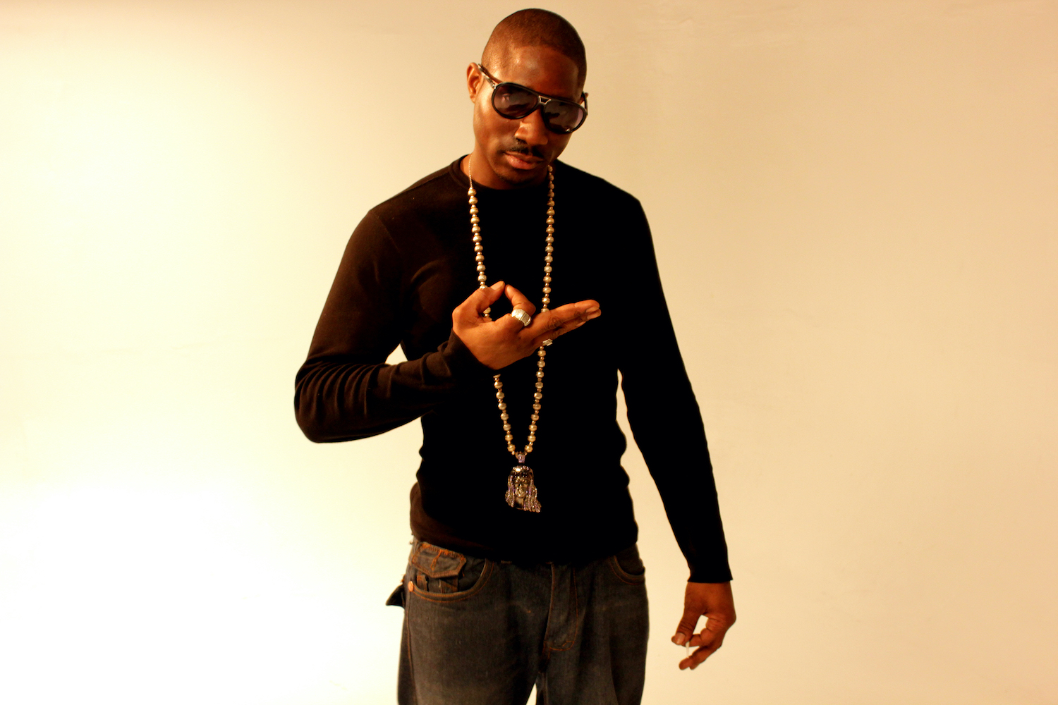 Professional Photography Black Man In Black Shirt Jeans Sunglasses And Platinum Chains Standing On White Studio Backdrop