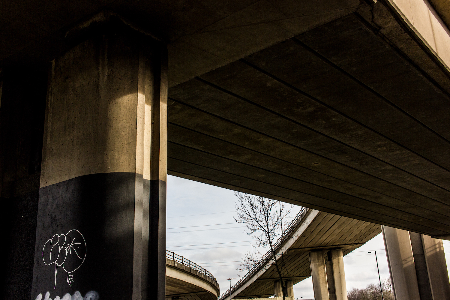 Professional Photography Concrete Roundabout In South Woodford North East London With Three Overpasses Graffiti And Pillars
