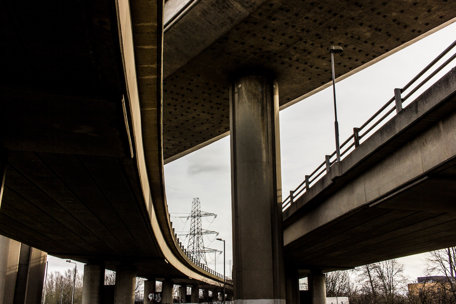 Professional Photography Concrete Roundabout In South Woodford North East London With Three Overpasses One Pillar And Electrical Tower
