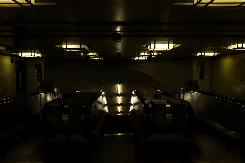 Professional Photography Interior Escalators With Fluorescent Light In Gants Hill Train Station London