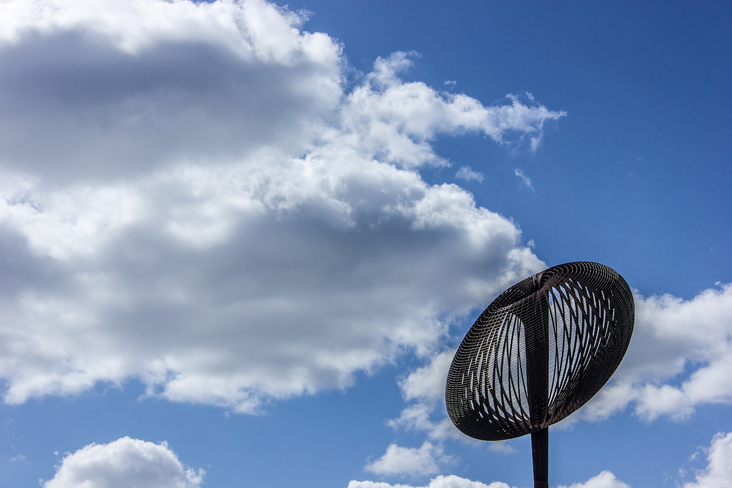 Professional Photography Egg Whisk Sculpture With Blue Sky And Clouds In Gants Hill London