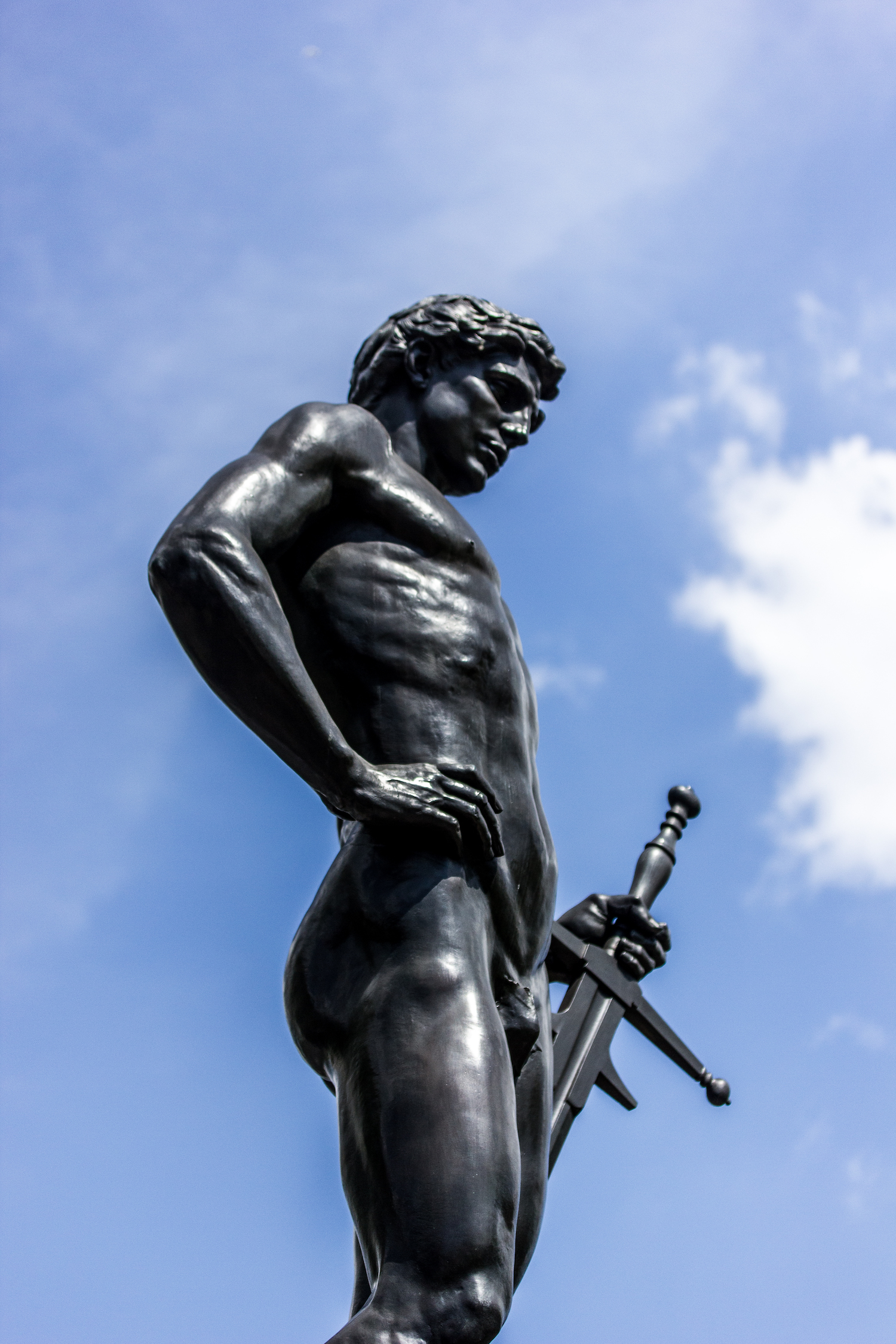Professional Photography Black Statue Of Man With Sword And Hand On Hip Blue Sky And Clouds In Hyde Park London