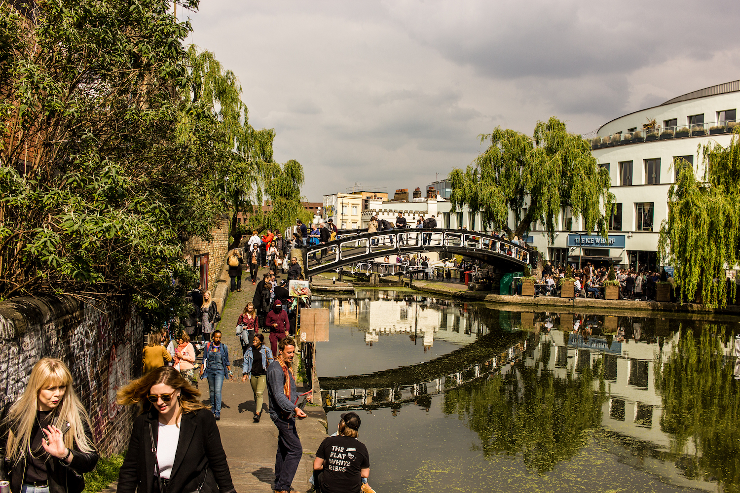 Professional Photography Landscape Of Camden Town Canal Riverside With People Walking Green Trees And Buildings
