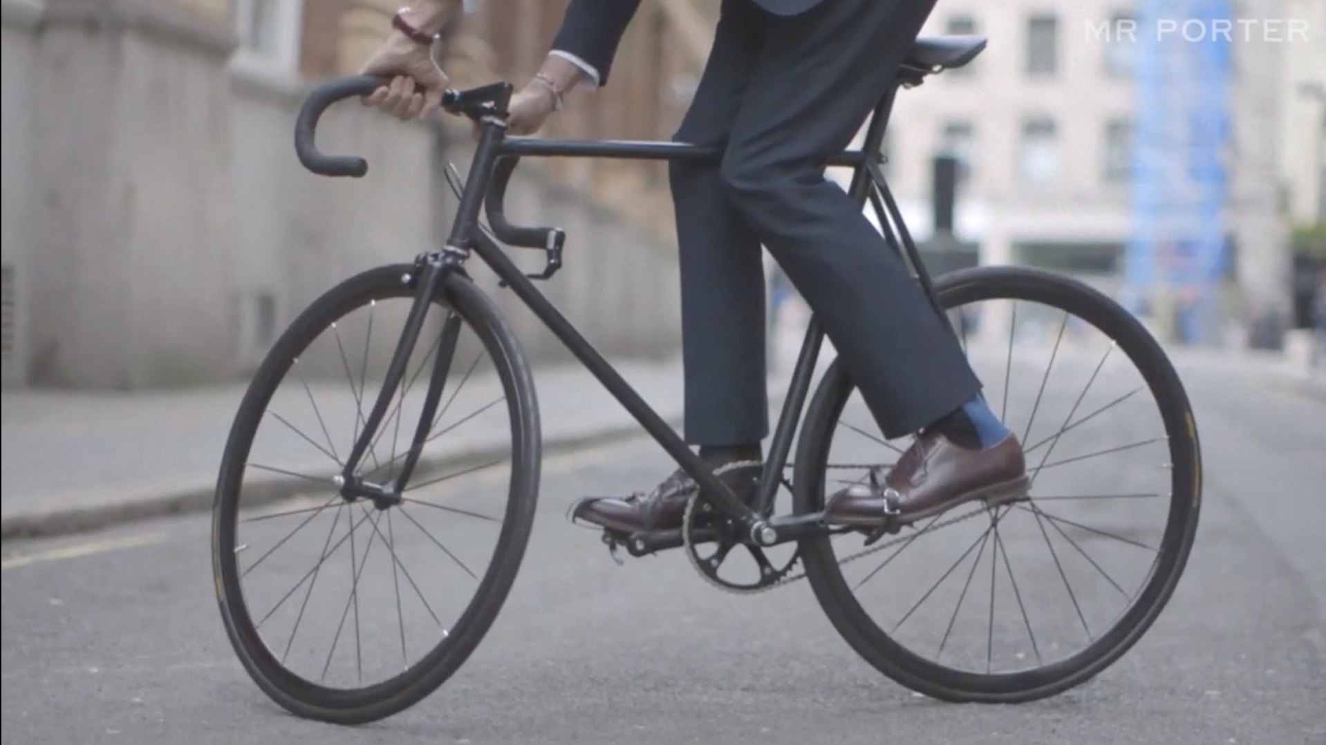 Fashion Designer In Blue Suit And Brown Leather Shoes Riding Custom Carbon Racing Bike On London City Street